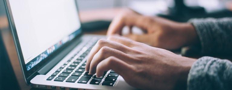 software developer at keyboard